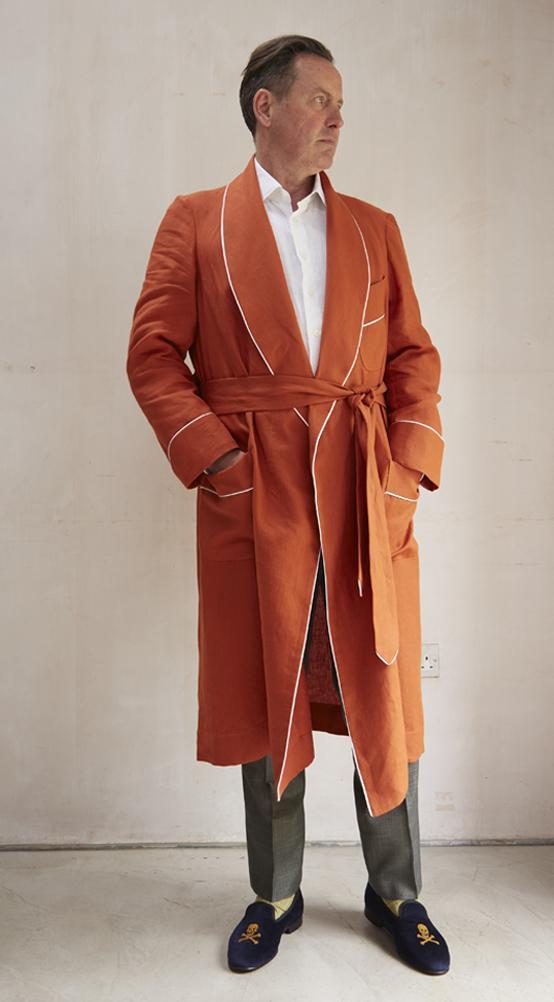 Ben Burdett wears the Orange Linen Dressing Gown
